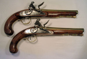 Click to enlarge a very fine pair of 21 bore flintlock brass barrelled travelling pistols by Bath & Co